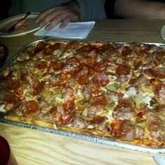 De Marini's Pizza in Milwaukee, WI. Phil and Dom's of course. The best pizza IN THE WORLD!!!!