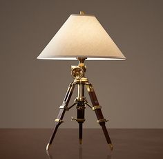 Royal Marine Tripod Table Lamp Antique Brass by Restoration Hardware. The tripod harkens to classic architecture, while the brass accents are just very steampunk.