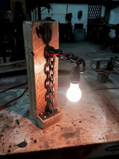 A new twist on the welded chain lamp. Metal Art Projects, Diy Wood Projects, Lampe Metal, Lighting Concepts, Horseshoe Art, Automotive Furniture, Cool Lamps, Welding Art, Pipe Lamp