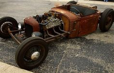Awesome patina'd T-bucket with a flathead.