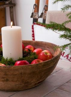 Pretty bowl with red apples, greeneries and white candle_Love for all Seasons