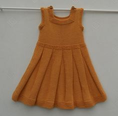 Baby girl/toddler dress or pinafore hand knitted in by TradKnits