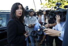 Lisa Damiani, an attorney speaking for Robert and Arlene Holmes, parents of of mass shooting suspect James Holmes, talks to reporters as she leaves the family home July 20, 2012 in the Rancho Penasquitos area of San Diego, California.  http://www.zimbio.com/pictures/1-P1Mi0EGSK/Media+Gather+Outside+Home+Aurora+Shooting/Ull--1DQVMy
