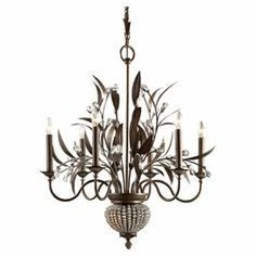 """Showcasing cut crystal blooms set among frond-inspired accents, this beautiful chandelier pairs a timeless silhouette with natural details.  Product: ChandelierConstruction Material: Crystal and metalColor: BronzeAccommodates: (6) 60 Watt candelabra bulbs and (2) 7 watt nightlights - not includedDimensions: 33"""" H x 27"""" Diameter"""