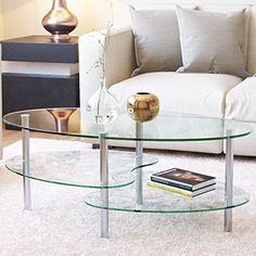This stylish, contemporary oval two-tier all clear glass coffee table offers multiple levels to showcase magazines, books and more. It's distinctive curved legs support tempered safety glass and a frosted lower shelf. Each glass shelf features beveled edges for a smooth, soft edge. Three... more details available at https://furniture.bestselleroutlets.com/living-room-furniture/tables/coffee-tables/product-review-for-ryan-rove-ashley-38-inch-oval-two-tier-all-clear-glass-