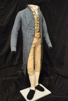 "1780s suit worn by American Revolutionary War patriot Samuel Cutts - ""The fabric for the coat was most likely English but cut and tailored in New England/New Hampshire, while the vest was probably pieced together from a kit. The slim cut of the breeches underscore that this was not the garb of a man involved in physical labor. The ensemble emphasized a lean silhouette with shallow pockets or artificial flaps, all serving to eliminate bulk. There are no coat skirts or extraneous material."""