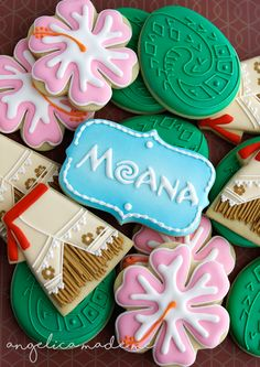 Disney Moana themed sugar cookie set. Hibiscus, Moana's skirt, heart of tefiti, plus, custom name cookies for the kiddos. Decorated with royal icing.