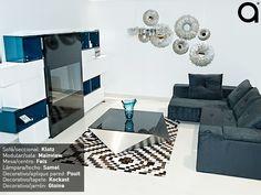 Experiencia Matisses: Para convertir la sala como el lugar de relajación con estilo innovador, se puede incluir un módulo de TV con diseño vanguardista y superficies limpias. Elegir un sofá que dote el espacio de elegancia, así como un tapete con estampado cautivante, hará de este lugar el más destacado de la casa.