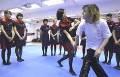 Hong Kong Airlines cabin crew learning self defence to cope with aggressive passengers. Kung Fu Moves, Hong Kong Airlines, Airline Cabin Crew, What Is Positive, Attendance, Flight Attendant, Female, Guys, Learning