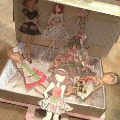 Handmade suitcase and paper dolls created by Bona Rivera-Tran.