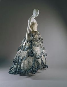 """#FashionFlashback: here's the """"Junon"""" dress created by Christian Dior for his F\W 1949 collection. The dress was made out of a pale-blue silk net embroidered with iridescent blue, green, and rust sequins.The dress has inspired the costume for Glinda in the musical """"WIcked"""", and also a number from ZUHAIR MURAD which was worn by Miley Cyrus at Oscars in 2009.it is now kept at of the Metropolitan Museum of Art in New York."""