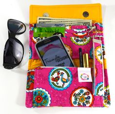 https://trampleedesigns.etsy.com This adorable Wallet Clutch has Everything you need, a bunch of card slots, plenty of pockets, one with a zipper for your change and a wrist strap that doubles as a key ring. #Ladies #Wallets - #Fabric Wallet - #Wristlet #Purse - #Clutch Wallets - #Stylish Wallets - #Women's Wallet - #Female Wallets - #Trifold Wallets - pinned by pin4etsy.com