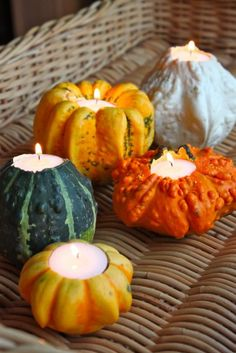 using pumpkins and gourds to create candle holders for fall or halloween decorating ideas for the table - from pinterest