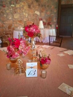 Wedding Flowers. Ceremony Centerpieces. Gold mercury Vases. Gold mercury stands. Pink Flowers. Pink Hydrangea. Pink roses. Antique Hydrangea. Seeded Eucalyptus. Tablescape. Table centerpiece. Clustered flowers. Clustered arrangements. Gold and Pink. Bold Pink flowers. Oakleaf Florist.