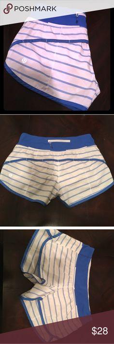 """Lululemon """"speed"""" running short Size 4 Blue and white striped running shorts from Lululemon. Back zipper pocket. Great condition. Size 4 lululemon athletica Shorts"""