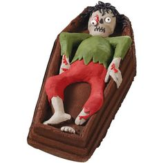 Too Ghoul Casket 3-D Cake - Cause a fright and some delight when you serve this eerie cake this Halloween! Wilton Dimensions® Skeleton In Casket 3-D Pan gives this character his gruesome shape.