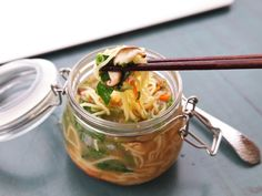 This pot of noodles with miso, sesame, and a ton of fresh vegetables can be made ahead and taken to work. Just add boiling water, seal it up for three minutes, add the contents of the fresh scallion packet, and you've got a hot lunch ready.\n