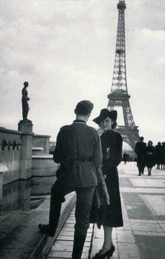 Dangerous liaisons: A French woman poses with a Nazi officer at the Eiffel Tower during the period of German occupation in the Second World War, when many French people lived in close quarters with the enemy under the Vichy regime