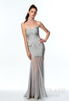Stapless machine knit bandage gown with a sweetheart neckline, modified peplum, and rhinestone detailing. the dress is finished with flowing chiffon from skirt to hem