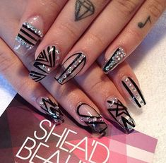 Black and clear polish abstract nail art combination. You can deviate away from the usual colorful abstract nail art and go with a simpler and classier one. Add embellishments on top for effect.