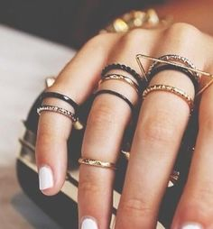 Delicate black and gold ring stacks.