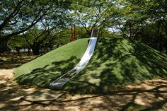 Slide built into a hill!... thinking I'm going to need a pretty big yard at this 'dream home' :)
