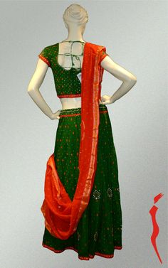 Cotton green lehenga with thread embroidery botta comes with cotton blouse and orange bandhini dupatta.