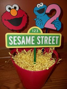 "Cut out with Silhouette, could also decorate red bucket to look like Elmo; think of something less ""messy"" and more toddler safe to put into bucket :)"