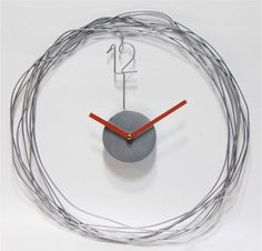 Minimalist modern design in metal wire gives this clock its distinctive style. Style # at Lamps Plus. Home Clock, Clock Art, Diy Clock, Contemporary Clocks, Modern Clock, Unusual Clocks, Cool Clocks, Living Room Clocks, Wall Watch