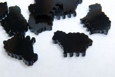 Tiny Black Sheep Cabochons - 10 pieces on Etsy, $5.50