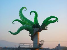Seeing street artist Filthy Luker's enormous, cartoon-like green tentacles bursting out of buildings and emerging atop monuments brings a huge smile to my face. Honestly, awesome.