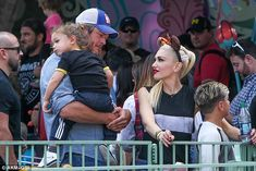 Shouldering the responsibility: Gwen Stefani seemed grateful to have beau Blake Shelton do the heavy lifting during a fun trip to Disneyland in Anaheim, CA with her boys on Wednesday