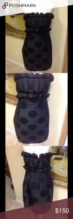 Marchesa black dress size 6 Stunning Marchesa black silk dress size 6. Beautiful pleated front, measures 30 inches in length, pristine condition, low price. Questions feel free to contact me. Marchesa Dresses Mini