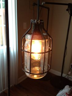 Hanging Jar Lamp- made by my own Matthew Powell. He sells these and they are wonderful. I have 2 in my home. Feel free to purchase them. He can customize them. They come with/without cages.