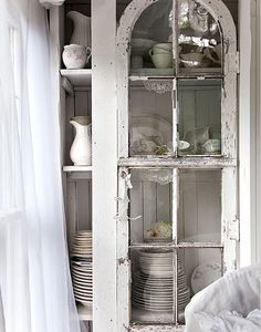 Lovely white painted hutch sideboard armoire with white china.