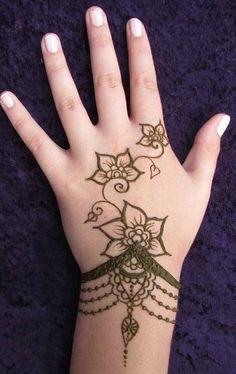 Beautiful flower henna design. LOVE