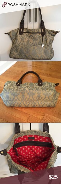 Stella & Dot Ikat Handbag Preloved Ikat, neutral outside with gold and silver, dark brown leather handles. Most of the wear is seen at the bottom corners as usual on canvas purses(see 2nd pic), but overall great stylish bag. Stella & Dot Bags Satchels