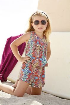Peixoto Kids Pearl Romper - The Peixoto Kids Pearl Romper is a great cover-up but also outfit of the day! The romper is beautifully cut to create a comfortable yet stylish fit. The open back of this designer kids mosaic romper is beautiful and adds a nice touch to this simple outfit. Its elaborate and classic print calls the attention of all young fashionistas. The Pearl Romper can be paired with the Tamarin bikini set and one piece as a cover-up or be worn alone for  all outings…