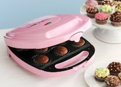 Babycakes Mini Cupcake Maker CC-8C by Intertek. $25.00. Nonstick Coated. Babycakes Cup Maker. Comes with Recipes. 150 Liners Included. Decorating Tools Included. Babycakes cupcake maker. Nonstick coated cups. Makes 8 mini cupcakes or pies. Includes 150 Paper liners and recipes. Also Includes Icing Bag, Decorating Tips- 4 different tips, Crust Cutting Tool- Perfectly cut and form pie crusts to fit the maker. Cute pink color.