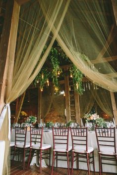 Hanging sheers in a barn...swoon! #barnwedding | Photography: http://laurenfairphotography.com | Design: www.oleanderbotanicals.com