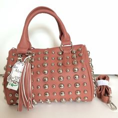 "HP Studded Alyssa bag! A gorgeous bag with removable strap extension.  Rock it short at elbow or wear with long adjustable strap for same shoulder or cross shoulder look!  So glam and fabulous!  Beautiful color with oversized tassel and silver studs.  Front of bag is 12"" by 8"".  Bottom of bag is 11.5"" by 5"".  Vegan and lead free.  Brand new!! Alyssa Bags"