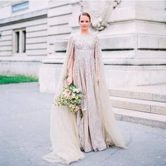 Would you consider a cape instead of a veil? We absolutely love this look!👰🏼👏🏼💕 #Repost @thewedlist ・・・ Dress by @krikorjabotian / Flowers by @lily_paloma_flowers / Photography by @audreyparisphoto / Hair and makeup by @harold_james / Wedding planning by @vanessa_creatricedemariages #weddingdress #cape #viel #champagne #glamorous #bride #brud #brudekjole #brudeslør #bryllup