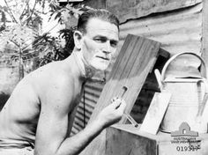 "Changi Prison Camp. Singapore. c. October 1945. VX42045 Corporal Harry Woodhead of Bon Beach, Vic, has a shave with a razor made in Changi prison camp by what he referred to as the firm of ""Woodhead, Barclay and Co."" In the last two years the prisoners of war (POWs) have made more than 500 such razors from scrap material in the gaol."