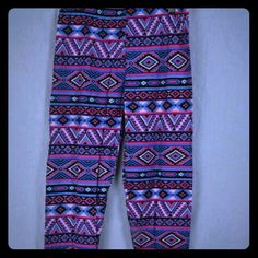 NWT Purple Pink And Blue Aztec Print Leggings This is a brand new pair of leggings by Magid. They were only taken out of the package to take pictures! They are purple, pink and blue aztec designs. The size chart for these are in the pictures. #new #aztec #leggings Magid Pants Leggings