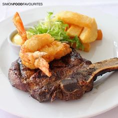 400gm dry aged rib eye on the bone, served with beer battered prawns, tarragon salted hand cut chip ($39 with wine Good Food Month menu) at Steersons Steakhouse, King Street Wharf