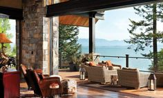 Lift and slide doors connect the great room to the deck, patio and world-class scenery beyond. Photo By: Heidi Long