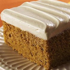 This easy pumpkin cake starts with a cake mix and is spiced with cinnamon and ground cloves.
