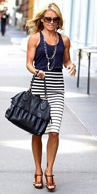 Love the skirt! Stripes are great and this gives a little something extra with different sized stripes