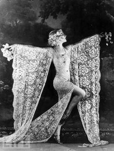 February 1926: Dancer Edmonde Guydens dancing at the Moulin Rouge nightclub in Paris in a costume made of lace.