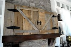 """One blogger hired a trim carpenter to create a """"barn door"""" for her TV. The reclaimed wood and hinges he used came from an actual barn that was about a hundred years old. Talk about vintage!"""